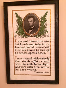 "<div class=""source"">Photo submitted</div><div class=""image-desc"">When Suzanne Hayden was preparing for her first long federal trial, she found a rumpled old print of an Abraham Lincoln quote and bought it. She has taken it all over the world with her and it resides in her office now.  ""It says everything"" she said.</div><div class=""buy-pic""></div>"