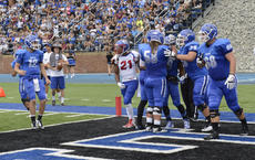 """<div class=""""source"""">COURTESY OF LINDSEY WILSON COLLEGE</div><div class=""""image-desc"""">Former Nelson County High School standouts Dylan Beasley (12) and Zac Lawson (78) celebrate a touchdown for Lindsey Wilson College. Beasley and Lawson are starters for the NAIA No. 1 Blue Raiders.</div><div class=""""buy-pic""""></div>"""