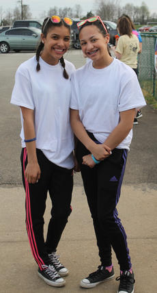 """<div class=""""source"""">RANDY PATRICK/The Kentucky Standard</div><div class=""""image-desc"""">Bardstown High School students Makayla Hamilton, left, and Savannah King wanted to show their support for the Reagan&#039;s Voice Foundation by participating in the 5K Color Run Saturday.</div><div class=""""buy-pic""""><a href=""""/photo_select/94530"""">Buy this photo</a></div>"""