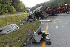 """<div class=""""source"""">RANDY PATRICK/The Kentucky Standard</div><div class=""""image-desc"""">The cab of the semi tanker that overturned on the Bluegrass Parkway near the 22 mile marker Tuesday evening was badly damaged, and the driver is listed in critical condition.</div><div class=""""buy-pic""""><a href=""""/photo_select/69485"""">Buy this photo</a></div>"""