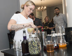 """<div class=""""source"""">PETER W. ZUBATY/The Kentucky Standard</div><div class=""""image-desc"""">Karla Plott made sure to don her safety glasses before diving into the chemistry of preparing Heaven Hill Distillery's entry for the 2018 Bourbon Capital Mixed Drink Challenge Tuesday at Spalding Hall.</div><div class=""""buy-pic""""><a href=""""/photo_select/97016"""">Buy this photo</a></div>"""