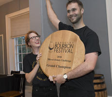 """<div class=""""source"""">PETER W. ZUBATY/The Kentucky Standard</div><div class=""""image-desc"""">Randi Densford and Dan Callaway celebrate winning the 2018 Bourbon Capital Mixed Drink Challenge Tuesday night at Spalding Hall. Their entry for the Bardstown Bourbon Company, """"The Modern Prometheus"""" earned the right to be the official cocktail of the 2018 Kentucky Bourbon Festival.</div><div class=""""buy-pic""""><a href=""""/photo_select/97015"""">Buy this photo</a></div>"""