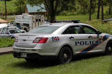 """<div class=""""source"""">KACIE GOODE/The Kentucky Standard</div><div class=""""image-desc"""">Police agency vehicles from Louisville were parked along the shores of Melody Lake Tuesday afternoon. </div><div class=""""buy-pic""""><a href=""""/photo_select/68035"""">Buy this photo</a></div>"""