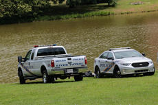 "<div class=""source"">KACIE GOODE/The Kentucky Standard</div><div class=""image-desc"">Louisville Metro Police, Louisville Metro Police River Patrol and Louisville Metro Underwater Search and Recovery were at Melody Lake Tuesday afternoon, but law enforcement officials would not give a reason for their visit.</div><div class=""buy-pic""><a href=""/photo_select/68033"">Buy this photo</a></div>"