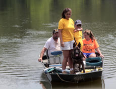 """<div class=""""source"""">KACIE GOODE/The Kentucky Standard</div><div class=""""image-desc"""">Bring them Home search and rescue, out of Florida, take a boat across an unoccupied section of Melody Lake as search efforts for Crystal Rogers continue from family and friends. Meanwhile, LMPD divers were on the other side of the lake, but would not say if their presence was related to an investigation. </div><div class=""""buy-pic""""><a href=""""/photo_select/68078"""">Buy this photo</a></div>"""