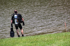 """<div class=""""source"""">KACIE GOODE/The Kentucky Standard</div><div class=""""image-desc"""">A diver with LMPD Underwater Search and Recovery waits for his partner to emerge Wednesday afternoon at Melody Lake. The officers were at the Lake for two days this week but would not confirm a reason for their presence. Sergeant Charles Robinson III said the team visits areas across Louisville and central Kentucky for various reasons, from investigations to training.</div><div class=""""buy-pic""""><a href=""""/photo_select/68077"""">Buy this photo</a></div>"""