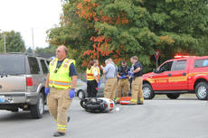 """<div class=""""source"""">RANDY PATRICK/The Kentucky Standard</div><div class=""""image-desc"""">Nelson County EMS personnel and Bardstown firefighters attend to the rider of a moped who collided with an SUV at the intersection of Cathedral Manor and West Stephen Foster Avenue just before 4:30 p.m. Monday. The rider refused treatment and transport. Bardstown Police Officer Tom Blair worked the incident.</div><div class=""""buy-pic""""><a href=""""/photo_select/69871"""">Buy this photo</a></div>"""