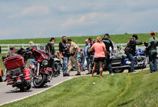 "<div class=""source"">KACIE GOODE/The Kentucky Standard</div><div class=""image-desc"">Bikers and motorist stand along Taylorsville Road Saturday afternoon after a motorcycle accident lead to a chain reaction for a large group of bikers moving through the Bloomfield area. Three people were sent to the hospital.</div><div class=""buy-pic""><a href=""/photo_select/67226"">Buy this photo</a></div>"