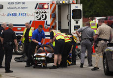 """<div class=""""source"""">FORREST BERKSHIRE/The Kentucky Standard </div><div class=""""image-desc"""">A man riding a motorcycle on West Stephen Foster Avenue was injured Friday afternoon when his bike collided with a pickup truck that turned in front of him. Bardstown Police Officer Andrew Riley said the biker, a local man, Jon Amshoff, was going east and the driver of the truck was going west about 1:30 when the truck turned in front of the bike, and the bike hit the truck in the side. The motorcyclist was transported to Flaget Memorial Hospital by Nelson County EMS. Sheriff's deputies, a Kentucky State Police trooper and Bardstown firefighters also responded. Amshoff's injuries were not life-threatening.</div><div class=""""buy-pic""""></div>"""