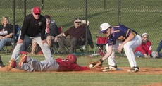 """<div class=""""source"""">PETER W. ZUBATY/The Kentucky Standard</div><div class=""""image-desc"""">Nelson County's Dawson Curtsinger slips into first past the tag by Bardstown's Michael McCormick in the Cardinals' 5-0 district championship win Thursday. Curtsinger scored twice in the game.</div><div class=""""buy-pic""""></div>"""