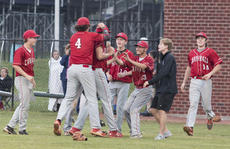 """<div class=""""source"""">PETER W. ZUBATY/The Kentucky Standard</div><div class=""""image-desc"""">Nelson County players mob teammate Benton McGill after the junior's complete-game shutout Thursday to beat Bardstown, 5-0, for the 19th District championship, the Cardinals' first since 2010.</div><div class=""""buy-pic""""></div>"""