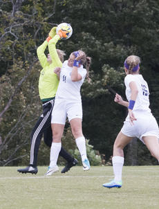 """<div class=""""source"""">PETER W. ZUBATY/The Kentucky Standard</div><div class=""""image-desc"""">Thomas Nelson's Caroline Boone (11) gets there too late as Nelson County keeper Savannah Jackson makes the leaping save. Jackson made three stops in the shootout Monday to lift the Cardinals to a 5-4 win.</div><div class=""""buy-pic""""></div>"""
