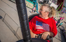 "<div class=""source"">KACIE GOODE/The Kentucky Standard</div><div class=""image-desc"">Diane Shields enjoys a spinning ride Friday during a special event at the Nelson County Fair.</div><div class=""buy-pic""><a href=""/photo_select/104482"">Buy this photo</a></div>"
