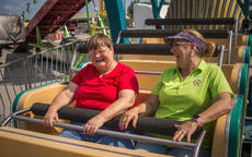 "<div class=""source"">KACIE GOODE/The Kentucky Standard</div><div class=""image-desc"">Fairgoers have a good time on a ride Friday as the fair opened early for some special guests.</div><div class=""buy-pic""><a href=""/photo_select/104483"">Buy this photo</a></div>"