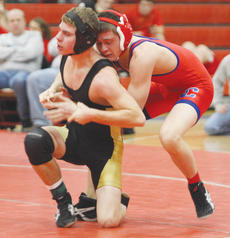 "<div class=""source"">Peter W. Zubaty</div><div class=""image-desc"">Nelson County senior Daniel Pile, right, gets a grip on a Boyle County wrestler Wednesday night. Pile is hoping to qualify for the state meet for the first time since 2009.</div><div class=""buy-pic""><a href=""/photo_select/22810"">Buy this photo</a></div>"