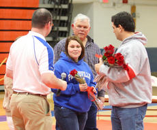 "<div class=""source"">Peter W. Zubaty</div><div class=""image-desc"">Support staff are often the unsung heroes who generally don't get their recognition until Senior Night, the way longtime team statistician Kimberly Schneider, center, did.</div><div class=""buy-pic""><a href=""/photo_select/22824"">Buy this photo</a></div>"