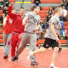 "<div class=""source"">Peter W. Zubaty</div><div class=""image-desc"">Four of Nelson County's five-man senior class perform warm-up laps around the mat to get ready for wrestling action Wednesday.</div><div class=""buy-pic""><a href=""/photo_select/22825"">Buy this photo</a></div>"