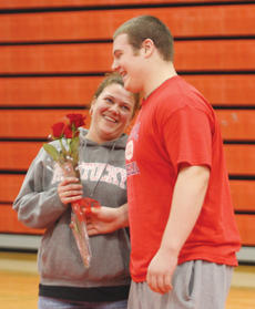 "<div class=""source"">Peter W. Zubaty</div><div class=""image-desc"">Senior Ryan Downs and his mother share a smile during Senior Night ceremonies.</div><div class=""buy-pic""><a href=""/photo_select/22827"">Buy this photo</a></div>"