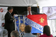 """<div class=""""source""""></div><div class=""""image-desc"""">Bardstown Mayor Dick Heaton presents a city flag to Dmitry Efimov.</div><div class=""""buy-pic""""><a href=""""/photo_select/90755"""">Buy this photo</a></div>"""
