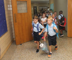 "<div class=""source"">RANDY PATRICK/The Kentucky Standard</div><div class=""image-desc"">After the school bell rings, it's off to classes for first-graders at St. Joseph Elementary Wednesday morning.</div><div class=""buy-pic""><a href=""/photo_select/88150"">Buy this photo</a></div>"