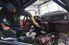 """<div class=""""source"""">KACIE GOODE/The Kentucky Standard</div><div class=""""image-desc"""">Ben Geoghegan show off the inside of race car Casper inside his New Haven garage. Geoghegan is a member of the Kentucky Street Outlaws racing group.</div><div class=""""buy-pic""""><a href=""""/photo_select/100528"""">Buy this photo</a></div>"""