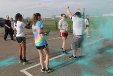 """<div class=""""source"""">RANDY PATRICK/The Kentucky Standard</div><div class=""""image-desc"""">Emma Mattingly and Maddie Ritchie cover a walker with washable paint  at one of the color run stations Saturday. Later, there was a paint war.</div><div class=""""buy-pic""""><a href=""""/photo_select/94531"""">Buy this photo</a></div>"""