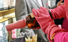 "<div class=""source"">KACIE GOODE/The Kentucky Standard</div><div class=""image-desc"">A bottle of special Evan Williams Single Barrel is dipped in pink wax during Heaven Hill's Fifty Shades of Pink Party May 4. The distillery still has bottles for purchase at the Bourbon Heritage Center, and a portion of sales goes to Flaget Memorial Hospital Foundation's Project Hope. </div><div class=""buy-pic""><a href=""/photo_select/95182"">Buy this photo</a></div>"