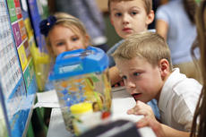"""<div class=""""source"""">KACIE GOODE/The Kentucky Standard</div><div class=""""image-desc"""">Kids line up to check out the new class pet, a beta fish, in a classroom at St. Catherine Academy. The New Haven Catholic school has been working to grow its enrollment and an upcoming annual event is helping make that happen.</div><div class=""""buy-pic""""><a href=""""/photo_select/82508"""">Buy this photo</a></div>"""