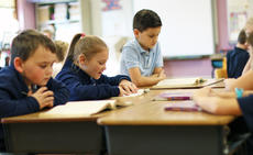 """<div class=""""source"""">KACIE GOODE/The Kentucky Standard</div><div class=""""image-desc"""">Second- and third-graders participate in a class reading exercise at St. Catherine Academy. The school is looking to grow and an upcoming benefit will help with tuition assistance.</div><div class=""""buy-pic""""><a href=""""/photo_select/82509"""">Buy this photo</a></div>"""