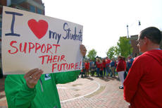 "<div class=""source"">KACIE GOODE/The Kentucky Standard</div><div class=""image-desc"">A teacher holds up a sign during a rally Wednesday supporting public education.</div><div class=""buy-pic""><a href=""/photo_select/94391"">Buy this photo</a></div>"