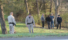 """<div class=""""source"""">RANDY PATRICK/The Kentucky Standard</div><div class=""""image-desc"""">Sgt. Ramon Pineiroa and Deputy Brandon Bryan, left, were among those who investigated a fatal accident early Thursday in some woods near 4050 Springfield Road.</div><div class=""""buy-pic""""></div>"""