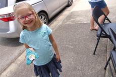 """<div class=""""source"""">KACIE GOODE/The Kentucky Standard</div><div class=""""image-desc"""">Lyric Edford, 6, shows off her Elsa rock after taking part in Suga Babies' rock painting party Saturday afternoon. The downtown event, as well as one in Bloomfield, means dozens of more decorated rocks for community members to find.</div><div class=""""buy-pic""""><a href=""""/photo_select/85387"""">Buy this photo</a></div>"""