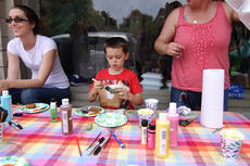 """<div class=""""source"""">KACIE GOODE/The Kentucky Standard</div><div class=""""image-desc"""">Jackson Wilcher paints a rock outside of Suga Babies on Flaget. The business hosted a rock painting party for kids to promote the family-friendly activity that has become popular this past month.</div><div class=""""buy-pic""""><a href=""""/photo_select/85390"""">Buy this photo</a></div>"""