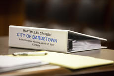 """<div class=""""source"""">FORREST BERKSHIRE/The Kentucky Standard</div><div class=""""image-desc"""">A binder filled with exhibits used in the removal hearing of Bardstown Mayor John Royalty sits on a table in a courtroom of the Nelson County Justice Center. The exhibits were collected during a three-month investigation commissioned by the Bardstown City Council.</div><div class=""""buy-pic""""><a href=""""/photo_select/84876"""">Buy this photo</a></div>"""