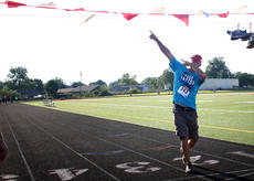 """<div class=""""source"""">KACIE GOODE/The Kentucky Standard</div><div class=""""image-desc"""">Jim Ballard poses as he crosses the finish line Monday at the annual Labor Day race event at Nelson County High School.</div><div class=""""buy-pic""""><a href=""""/photo_select/79279"""">Buy this photo</a></div>"""