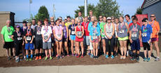 """<div class=""""source"""">KACIE GOODE/The Kentucky Standard</div><div class=""""image-desc"""">Division and overall winners gather for group shots Monday after the annual Labor Day race event at Nelson County High School.</div><div class=""""buy-pic""""><a href=""""/photo_select/79281"""">Buy this photo</a></div>"""