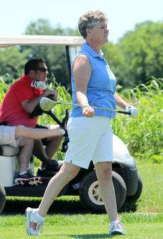"""<div class=""""source"""">DENNIS GEORGE/Contributing Photographer</div><div class=""""image-desc"""">Laura Mudd of VNA Health at Home watches her tee shot during Friday&#039;s Flaget Hospital scramble at Maywood.</div><div class=""""buy-pic""""></div>"""