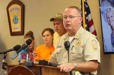 "<div class=""source"">RANDY PATRICK/The Kentucky Standard</div><div class=""image-desc"">Nelson County Sheriff Ed Mattingly, surrounded by members of Crystal Rogers' family, speaks at a press conference Monday afternoon at the Sheriff's Office.</div><div class=""buy-pic""><a href=""/photo_select/67393"">Buy this photo</a></div>"