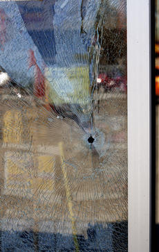 "<div class=""source"">FORREST BERKSHIRE/The Kentucky Standard</div><div class=""image-desc"">A bullet from a shooting in Bardstown near the Hardee's on North Third hit the window of Fisher's Auto Parts Tuesday afternoon around 3:15 p.m. No customers were in the store and no employees were injured. The bullet hit a shelf in the front of the store and busted a quart of oil.</div><div class=""buy-pic""><a href=""/photo_select/74917"">Buy this photo</a></div>"