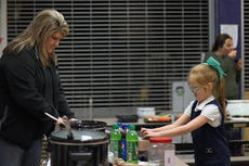 """<div class=""""source"""">KACIE GOODE/The Kentucky Standard</div><div class=""""image-desc"""">A child places a donation vote for a soup Monday night at Relay for Life's annual Souper Kickoff. The event raised over $1,500 for the local chapter, but efforts to raise more and increase participation will continue throughout the year. </div><div class=""""buy-pic""""><a href=""""/photo_select/82514"""">Buy this photo</a></div>"""