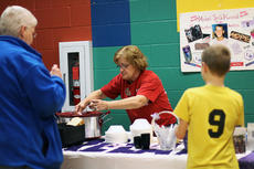 """<div class=""""source"""">KACIE GOODE/The Kentucky Standard</div><div class=""""image-desc"""">Longtime Relay participant Lou Smith serves her chicken and dumplings Monday night during the annual Souper Kickoff fundraiser. The event, held at Bardstown Middle School, raised more than $1,500. Smith walked away the night's winner, raising $280.50.</div><div class=""""buy-pic""""><a href=""""/photo_select/82515"""">Buy this photo</a></div>"""