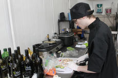 """<div class=""""source"""">RANDY PATRICK/The Kentucky Standard</div><div class=""""image-desc"""">Spencer Parks, son of owners Karen Kinzer and Wes Priddy, slices vegetables for salads at Rylon Sweeney's.</div><div class=""""buy-pic""""><a href=""""/photo_select/93750"""">Buy this photo</a></div>"""