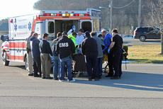 """<div class=""""source"""">LYNETTE MASON/The Spencer Magnet</div><div class=""""image-desc"""">EMS transported a man to Spencer County High School Thursday afternoon for transportation to Louisville by Air Methods. The man  suffered a stab wound to the back at a residence on Highview Church Road in Bloomfield. The Nelson County Sheriff's Office said the stabbing involved a domestic dispute.</div><div class=""""buy-pic""""></div>"""