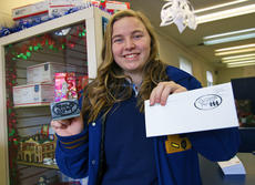 """<div class=""""source"""">KACIE GOODE/The Kentucky Standard</div><div class=""""image-desc"""">Bethlehem High School junior Lexi Morris poses with the cancellation stamp she designed for Nazareth this Christmas season.</div><div class=""""buy-pic""""><a href=""""/photo_select/82071"""">Buy this photo</a></div>"""