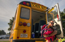 "<div class=""source"">KACIE GOODE/The Kentucky Standard</div><div class=""image-desc"">Edward Seay carries backpacks while helping unload a school bus as the 2019 school supplies drive comes to a close. The collection was led by the Old Kentucky Home Board of Realtors and the Fraternal Order of Police Old Kentucky Home Lodge 43.</div><div class=""buy-pic""><a href=""/photo_select/104634"">Buy this photo</a></div>"