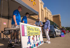 "<div class=""source"">KACIE GOODE/The Kentucky Standard</div><div class=""image-desc"">FOP members collect donations in front of Walmart as part of the annual school supplies drive.</div><div class=""buy-pic""><a href=""/photo_select/104637"">Buy this photo</a></div>"
