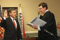 "<div class=""source"">RANDY PATRICK/The Kentucky Standard</div><div class=""image-desc"">Bardstown City Councilman Dick Heaton is sworn in as mayor by District Judge Jack Kelley Tuesday during a special council meeting.</div><div class=""buy-pic""><a href=""/photo_select/84979"">Buy this photo</a></div>"
