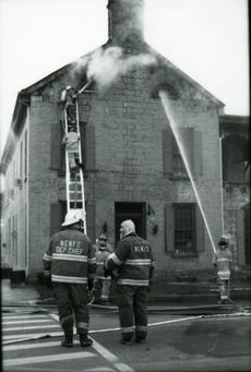 """<div class=""""source"""">FILE PHOTO</div><div class=""""image-desc"""">Firefighters work to extenguish the smoldering remains of the Talbott Tavern on the morning of March 7, 1998.</div><div class=""""buy-pic""""></div>"""