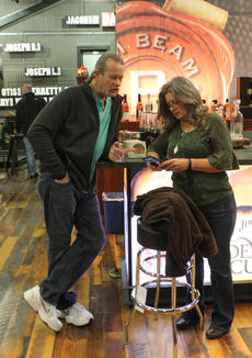"""<div class=""""source"""">RANDY PATRICK/The Kentucky Standard</div><div class=""""image-desc"""">Ron and Kim McKnight of Louisville hang out at the bar in the Jim Beam American Stillhouse right before dinner at the Holiday Feastival Friday night. Kim said her dad used to make whiskey in Nelson County.</div><div class=""""buy-pic""""><a href=""""/photo_select/91470"""">Buy this photo</a></div>"""