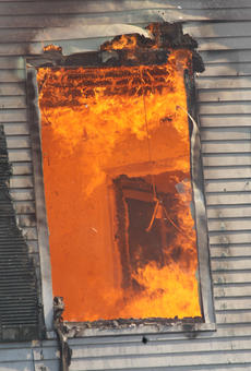 "<div class=""source"">RANDY PATRICK/The Kentucky Standard</div><div class=""image-desc"">A look through a front window of the house firefighters trained at on North Third Street Saturday shows the inferno raging inside.</div><div class=""buy-pic""><a href=""/photo_select/89513"">Buy this photo</a></div>"